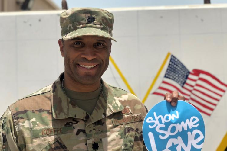 Lt Col Steven Coffee, US Air Force, holding a Show Some Love circle